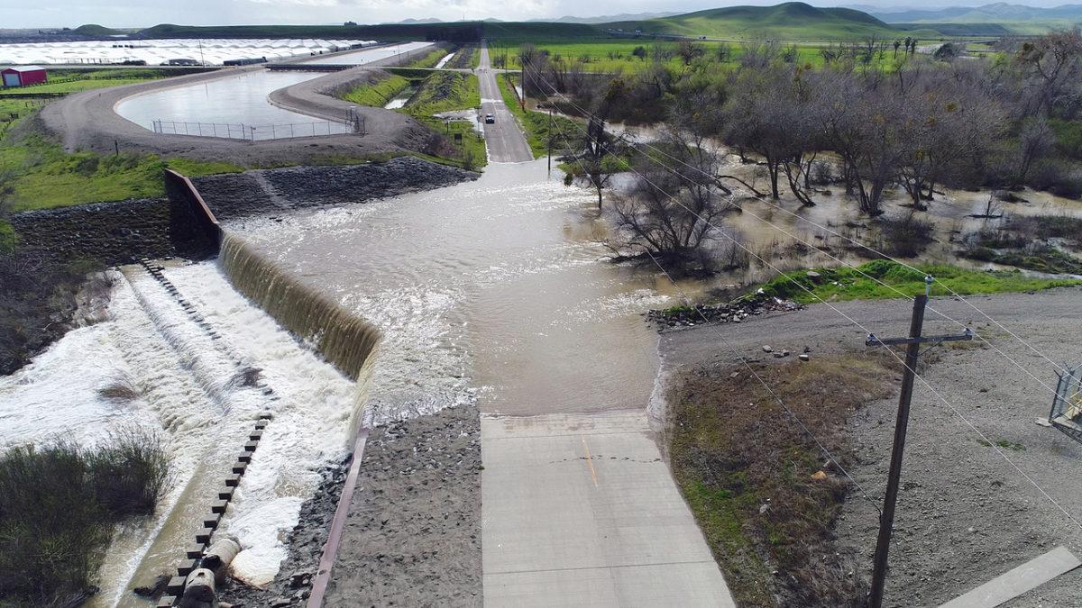 Rain-swollen Orestimba Creek floods roads near Newman