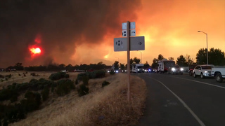 Fire whirls across road during Carr Fire